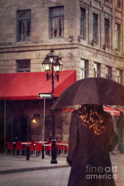 Photograph - Woman Walking With Umbrella On City Street In Montreal by Sandra Cunningham