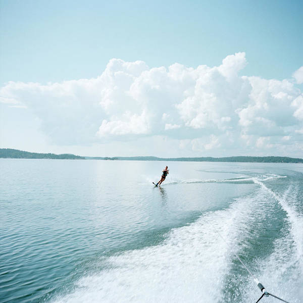 Waterskiing Photograph - Woman Water-skiing by Johner Images