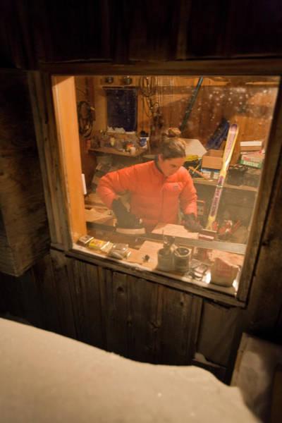 Jasmin Photograph - Woman Waxing Skis Through Window by Whit Richardson