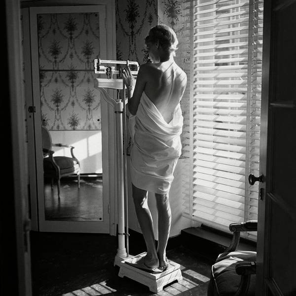 Towel Photograph - Woman Weighing Herself by Frances McLaughlin-Gill