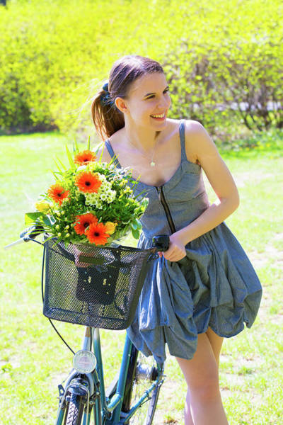 Wall Art - Photograph - Woman With Bicycle And Basket Of Flowers by Wladimir Bulgar/science Photo Library