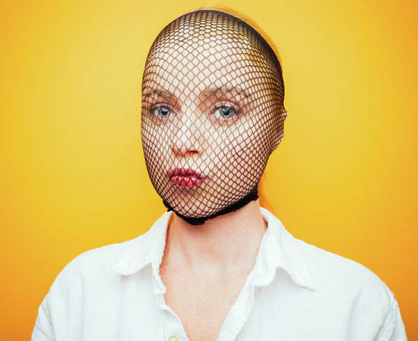 Covering Photograph - Woman With Fishnet Stocking Over Face by Ian Ross Pettigrew