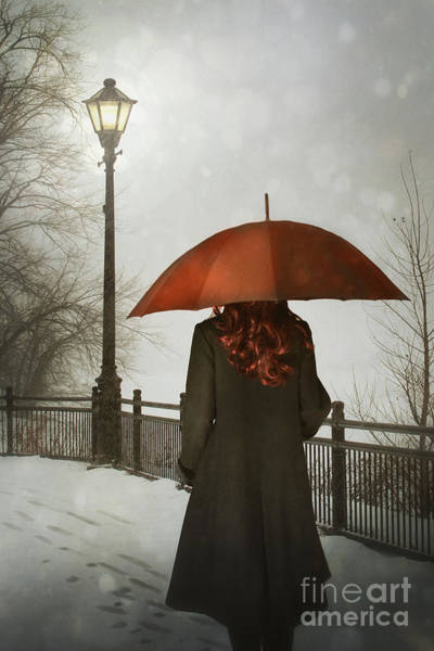 Photograph - Woman With Umbrella Walking Alone At Night  by Sandra Cunningham