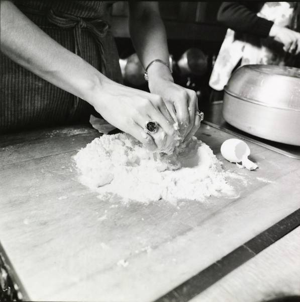 Wall Art - Photograph - Woman's Hands Mixing Dough by Ernst Beadle