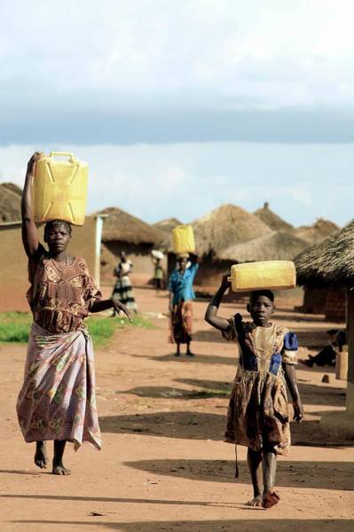 Wall Art - Photograph - Women And Children Carrying Water by Mauro Fermariello/science Photo Library