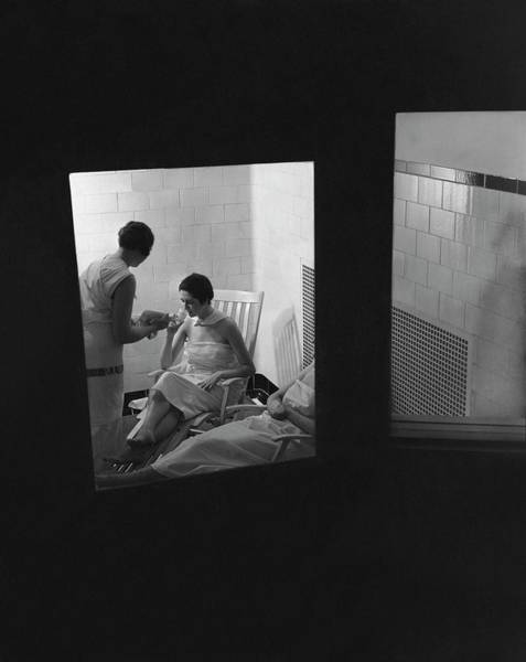 Relaxation Photograph - Women Relaxing In A Hot Room by Lusha Nelson