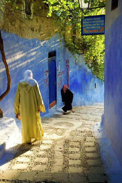 Chefchaouen Wall Art - Photograph - Women Walking Through Blue Street by Tony Burns