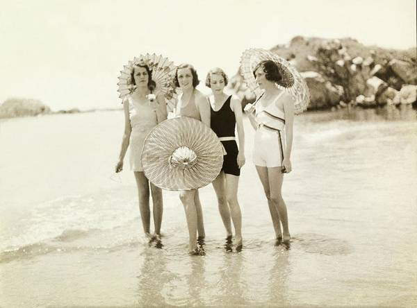 Swimsuit Photograph - Women Wearing Bathing Suits On A Beach by Toni Frissell