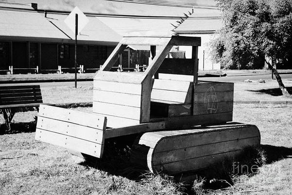 Wall Art - Photograph - wooden bulldozer in a childrens play area with grafitti star of david scraped onto the side Punta Arenas Chile by Joe Fox