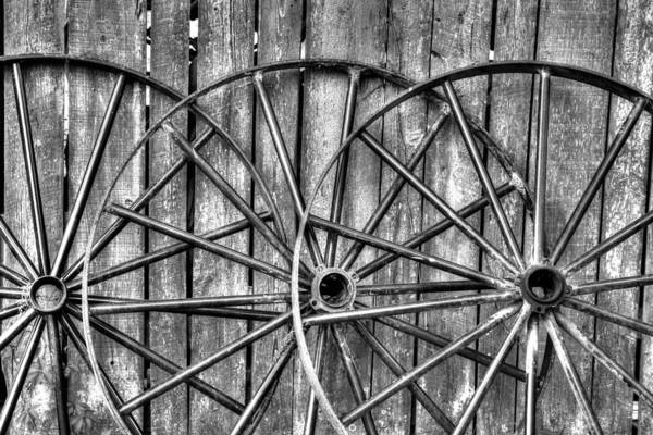 Wagon Wheel Photograph - Wooden Fence And Old Wagon Wheels by Darrell Gulin
