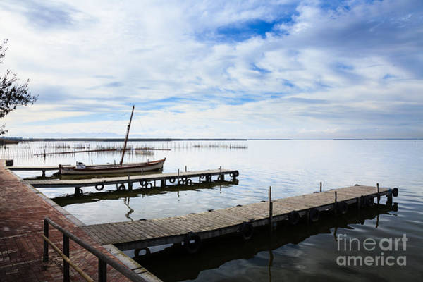 Photograph - Wooden Jetties On The Stillness Of Lake Albufera Spain by Peter Noyce