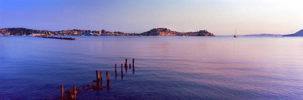 Elba Photograph - Wooden Posts In Sea, Portoferraio by Panoramic Images