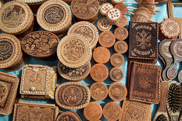 Retail Photograph - Wooden Souvenirs For Sale At Market by Holger Leue
