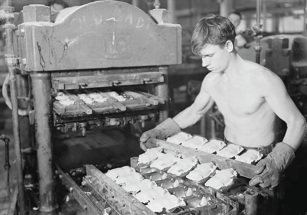 Doll Parts Photograph - Worker Pressing Rubber Bodies For Doll by Stocktrek Images