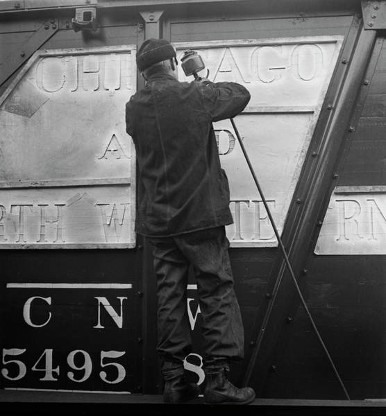 Freight Trains Painting - Worker Stenciling The Name by Stocktrek Images