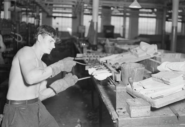 Doll Parts Photograph - Worker Stripping Rubber Bodies by Stocktrek Images