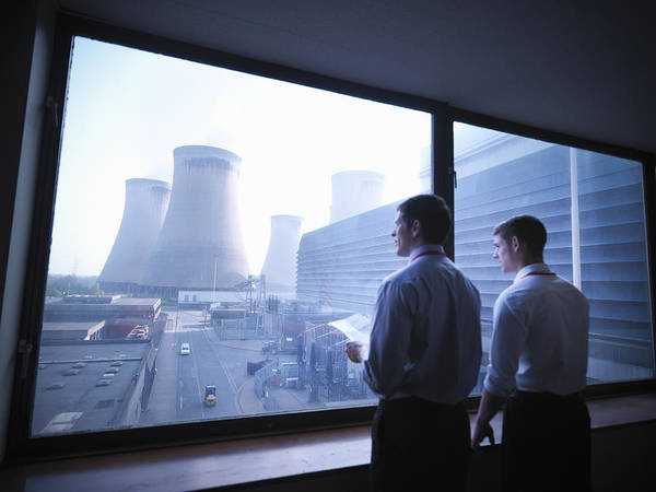 Workers Looking Out Over Power Station Art Print by Monty Rakusen