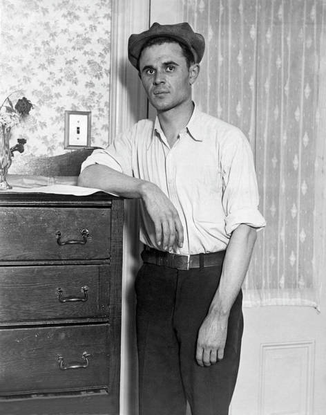 Chest Of Drawers Photograph - Working Man Portrait by Underwood Archives
