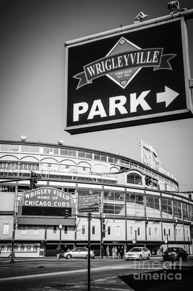 Editorial Photograph - Wrigleyville Sign And Wrigley Field In Black And White by Paul Velgos