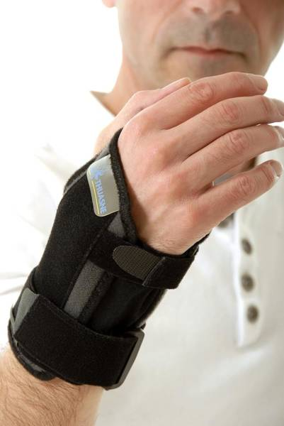 Bracing Photograph - Wrist Brace by Science Photo Library
