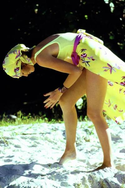 Swimsuit Photograph - Yasmine Sokal Wearing A Yellow Ensemble by Arthur Elgort