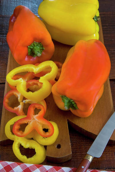Bell Peppers Photograph - Yellow And Red Peppers Or Bell Pepper by Nico Tondini