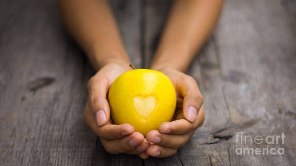 Wall Art - Photograph - Yellow Apple With Engraved Heart by Aged Pixel