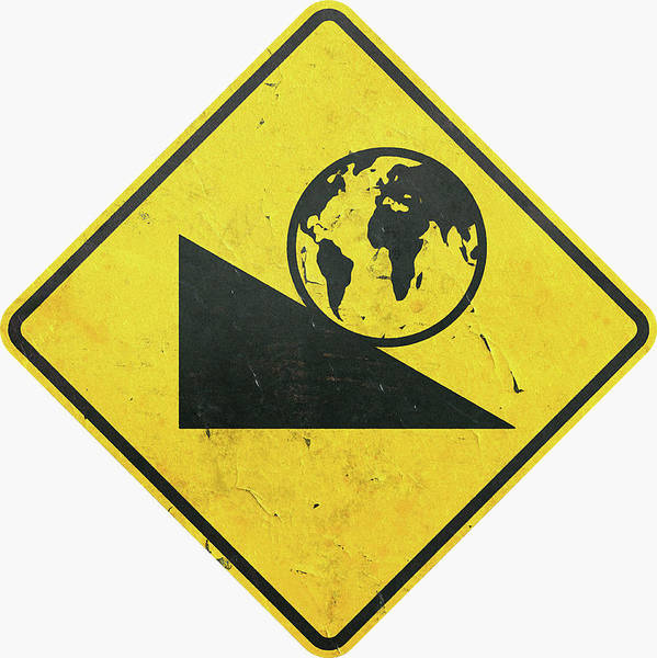 Wall Art - Photograph - Yellow Caution Sign With Globe Rolling by Ikon Ikon Images