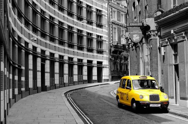 Yellow Taxi Photograph - Yellow Taxi In London by Jim Hughes