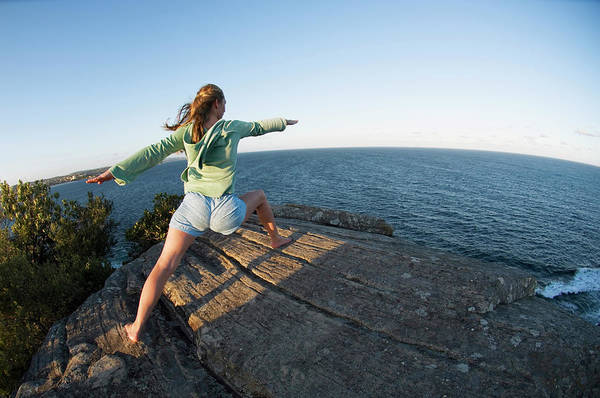 Breeze Photograph - Yoga On Rocky Outcrop Above Ocean by Lars Schneider