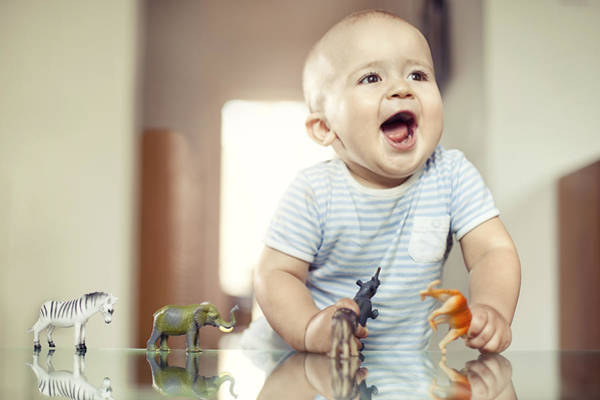 Young Boy Playing With Toy Animals Art Print by Orbon Alija