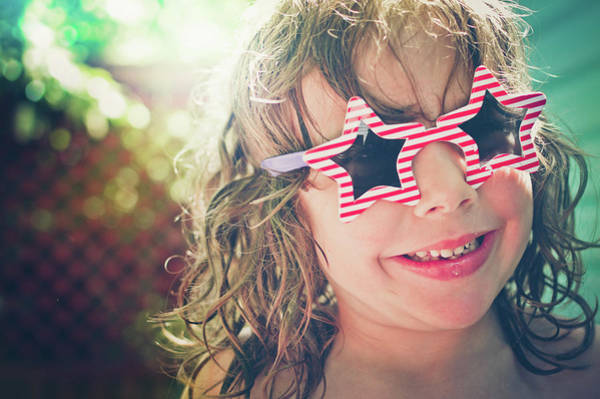 Toothy Smile Photograph - Young Boy Wearing Patriotic Sunglasses by Fran Polito