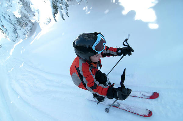 New Years Day Photograph - Young Boy With Helmet On Alpine Skiing by Joe Klementovich