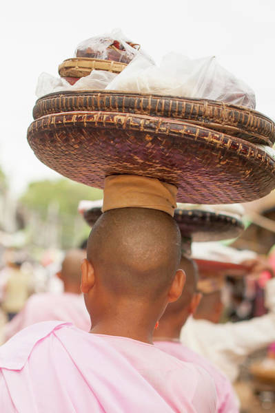 Shaved Head Photograph - Young Buddhist Monks Carrying Baskets by Cultura Rm Exclusive/yellowdog