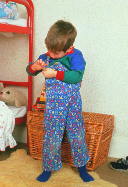 Dressing Photograph - Young Child Adjusting His Dungarees by Ron Sutherland/science Photo Library