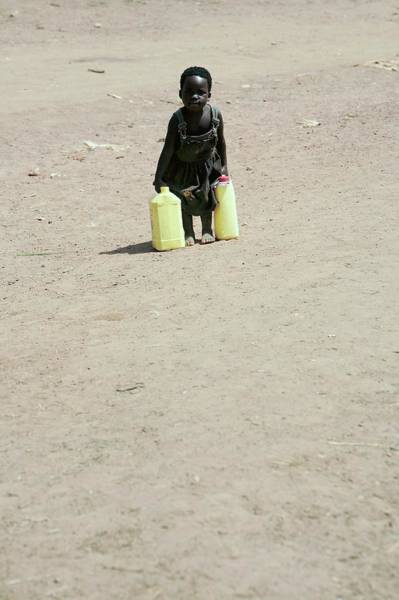 Wall Art - Photograph - Young Child Carrying Water by Mauro Fermariello/science Photo Library