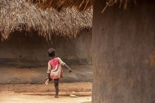 Uganda Wall Art - Photograph - Young Child In A Village by Mauro Fermariello/science Photo Library