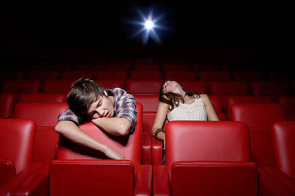 Young Couple Asleep In The Movie Theater Art Print by Image Source