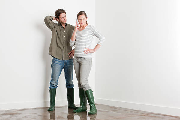 Young Couple On Flooded Floor Art Print by Image Source