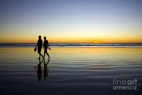 Broome Photograph - Young Couple Walking On Romantic Beach At Sunset by Colin and Linda McKie