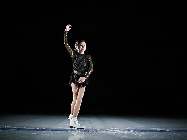 Hand Photograph - Young Female Figure Skater Finishing by Thomas Barwick