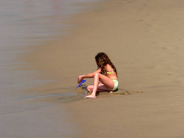 Photograph - Young Girl Playing In Sand At Beach by Jeff Lowe