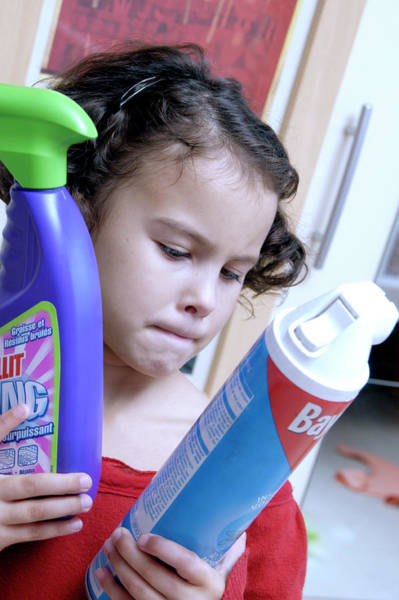 Wall Art - Photograph - Young Girl With Cleaning Products by Aj Photo/science Photo Library