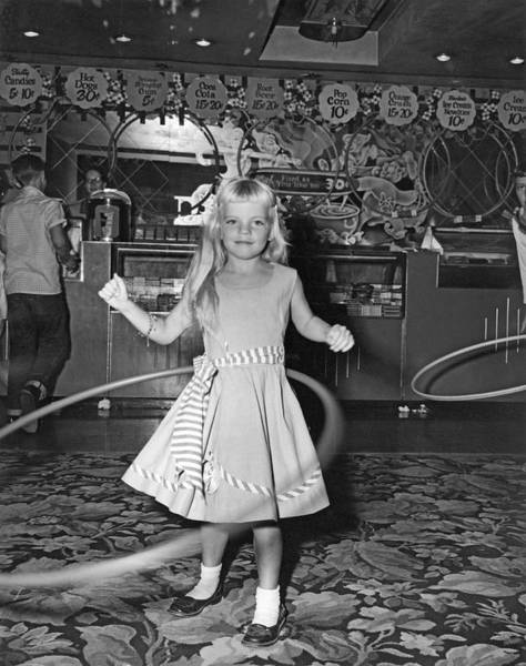 1958 Movies Photograph - Young Girl With Hula Hoop by Underwood Archives