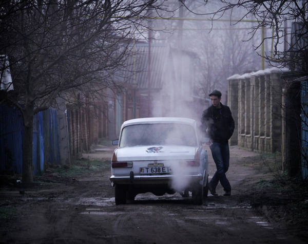 Moldova Wall Art - Photograph - Young Man And His Car by Amos Chapple