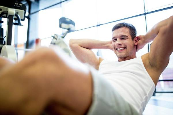Abdominal Photograph - Young Man Exercising by Science Photo Library