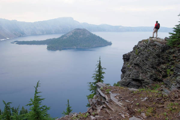 Active Volcano Photograph - Young Man Hiking At Crater Lake by Justin Bailie