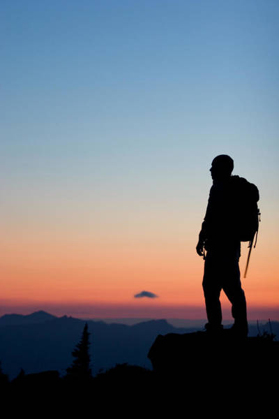 Wall Art - Photograph - Young Man Hiking In Mount Rainier by Justin Bailie