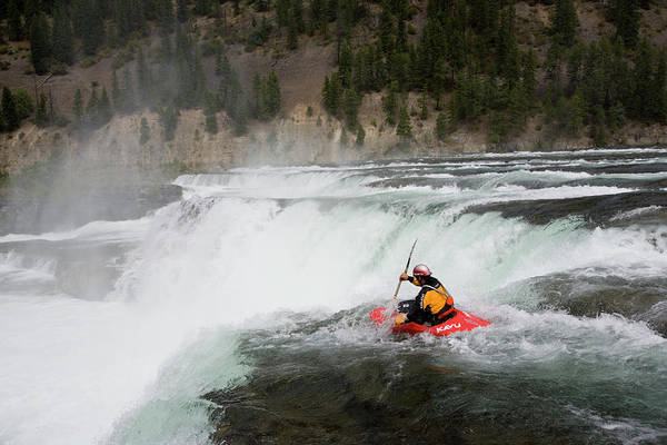 Whitewater Falls Photograph - Young Man Kayaking Over Kootenai Falls by Henry Georgi