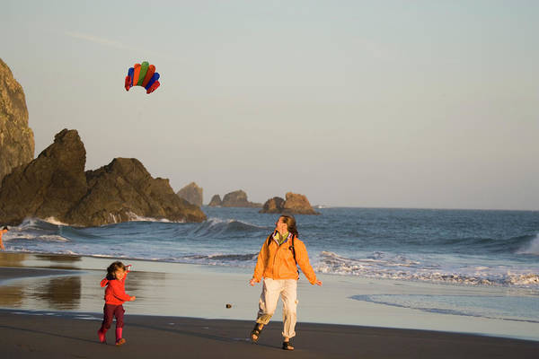 All Together Photograph - Young Mother And Daughter Fly Kite by Henry Georgi